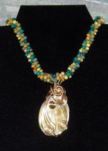 Teresa McMahon wrapped this mother of pearl shell in gold-filled wire.