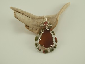 Bryan Cook wrapped this Unakite and sea glass pendant.