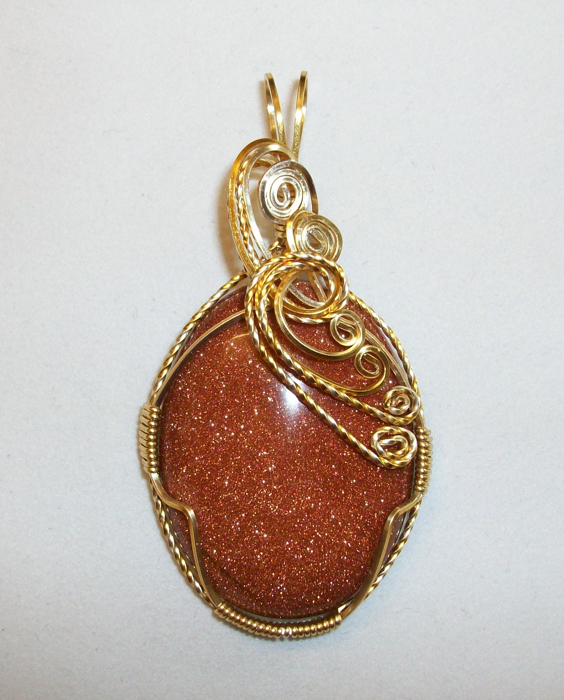 Origins of goldstone which is not a stone or gold jewelry joan madouse wrapped this brown goldstone pendant in gold plated wire mozeypictures Gallery