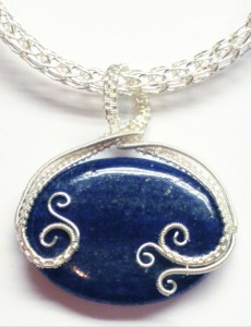 Judy Larson used 2 gauges of wire and a 30x40 Lapis bead to make this pendant.