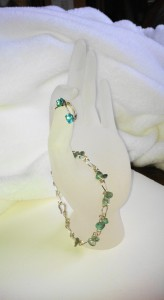 This apatite bracelet is made from Argentium silver wire, with matching earrings, made by Jane Duke.