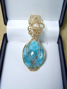 Judy Copeland wrapped this larimar pendant in gold-filled wire with a focal freshwater pearl surrounded in twisted gold-filled filigree.