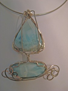 "Linda Barton created her ""Sail Away"" pendant, wrapping two Larimar stones in sterling silver wire. Measures 3""x2""."