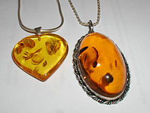 Amber pendants made of modified amber. The oval pendant is 52 by 32 mm (2 by 1.3 inches).