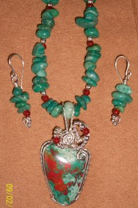 Cuprite wrapped necklace in sterling wire along with amazonite chips and carnelian accents by Shawnea Hardesty.