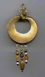 Custom designed for a museum curator, the solid gold ring was either a nose or ear ring for a person of status within a pre-Columbian tribe of South America. To protect the artifact, Dale used super-soft goat hide as a padding between the item and her handcrafted 14k wire frame; which was then embellished using natural gemstone beads.